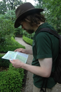 Andy with the map at the Arboretum ... in his fedora ... and his cargo shorts