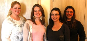 The Crosshair Press staff (left to right: Carrie Lemke, Katie Morford, Amy Davis, and Amy Williams)