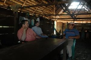 Missionaries Jim Dinsmore, Jay Brown and Kekchi national pastor Abelino in a Kekchi home in Peten, Guatemala