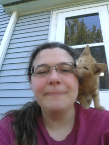 Me with my kitten, Pond, enjoying cool weather (yes, Pond, is chewing on my glasses)