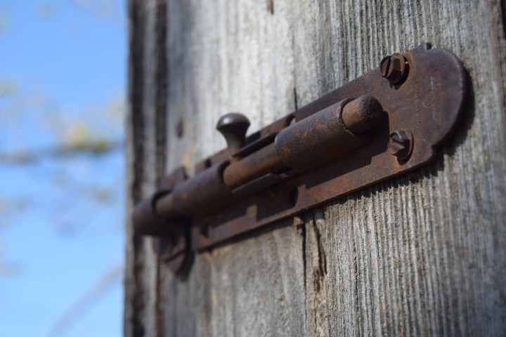 Rusty latch on the old chicken coop door