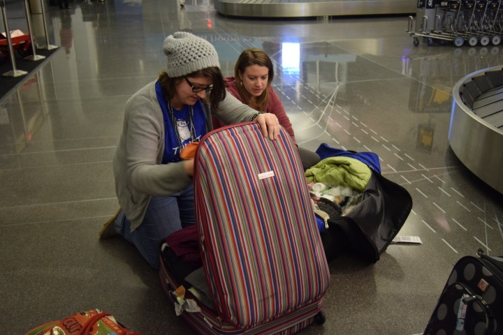 Katie and Amy were so glad to be home, they started unpacking in the airport!